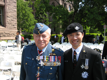 "Maj. General Richard Rohmer and Derwin Mak at the D-Day 65th Anniversary Ceremony, Queen's Park, Toronto, June 6, 2009. Gen. Rohmer flew over Normandy on D-Day. Interestingly, Gen. Rohmer is also a science fiction writer of a sort; in the 1970's and 1980's, he wrote some ""future history"" novels such as Separation (Quebec separates) and Ultimatum (U.S. invades Canada) and technothrillers such as Starmageddon (U.S.-Soviet space war) and Periscope Red (Soviet submarine)."
